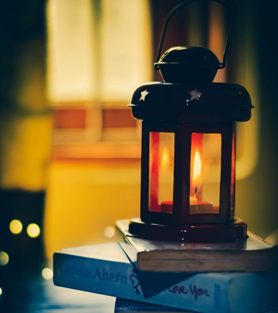 lantern on pile of books