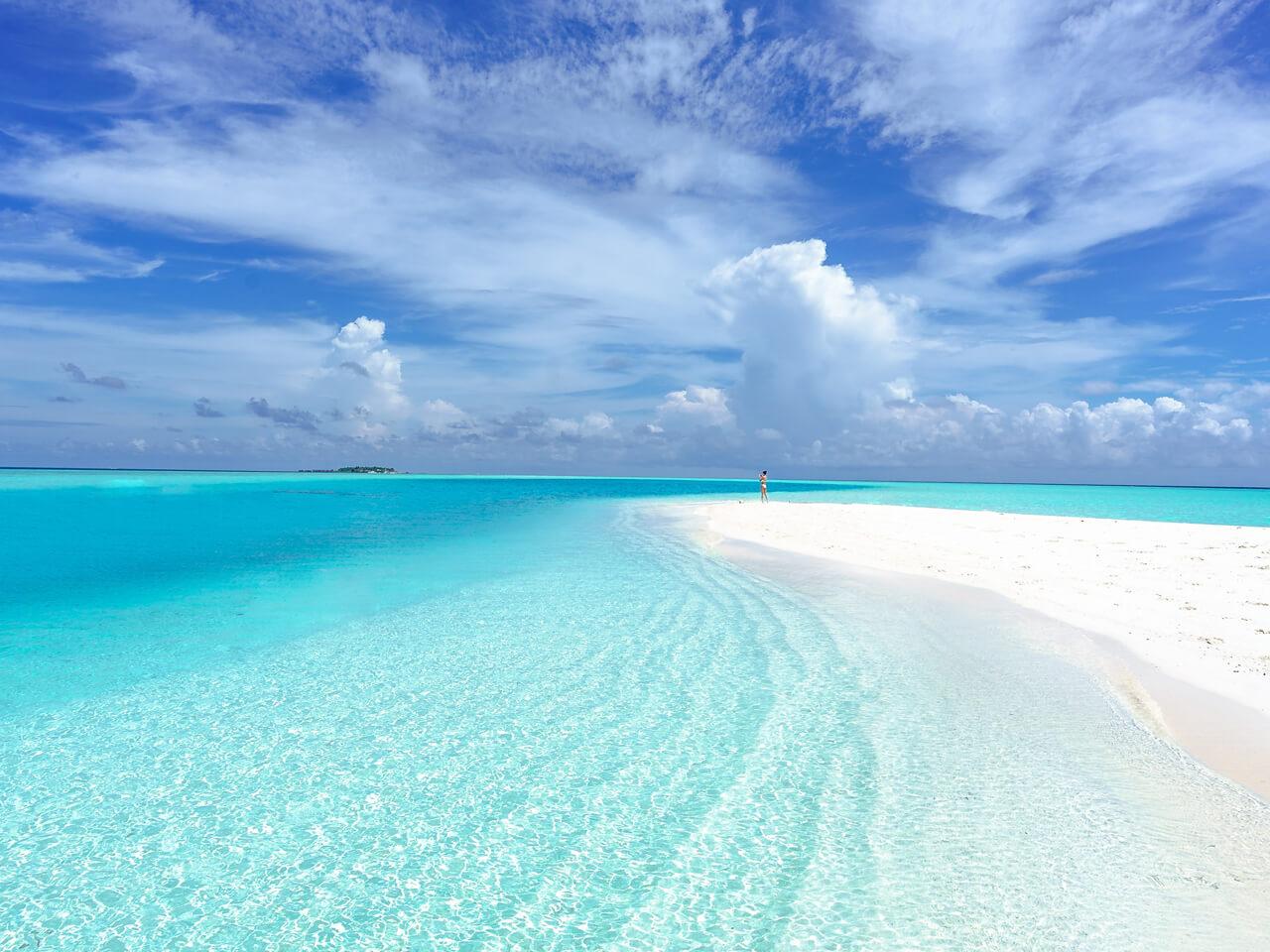 white sandy beach blue sea